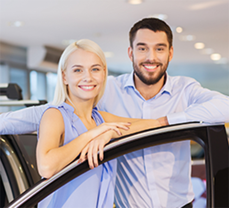 woman and man shopping for a new car