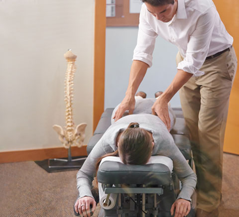Man being adjusted by Chiropracticor